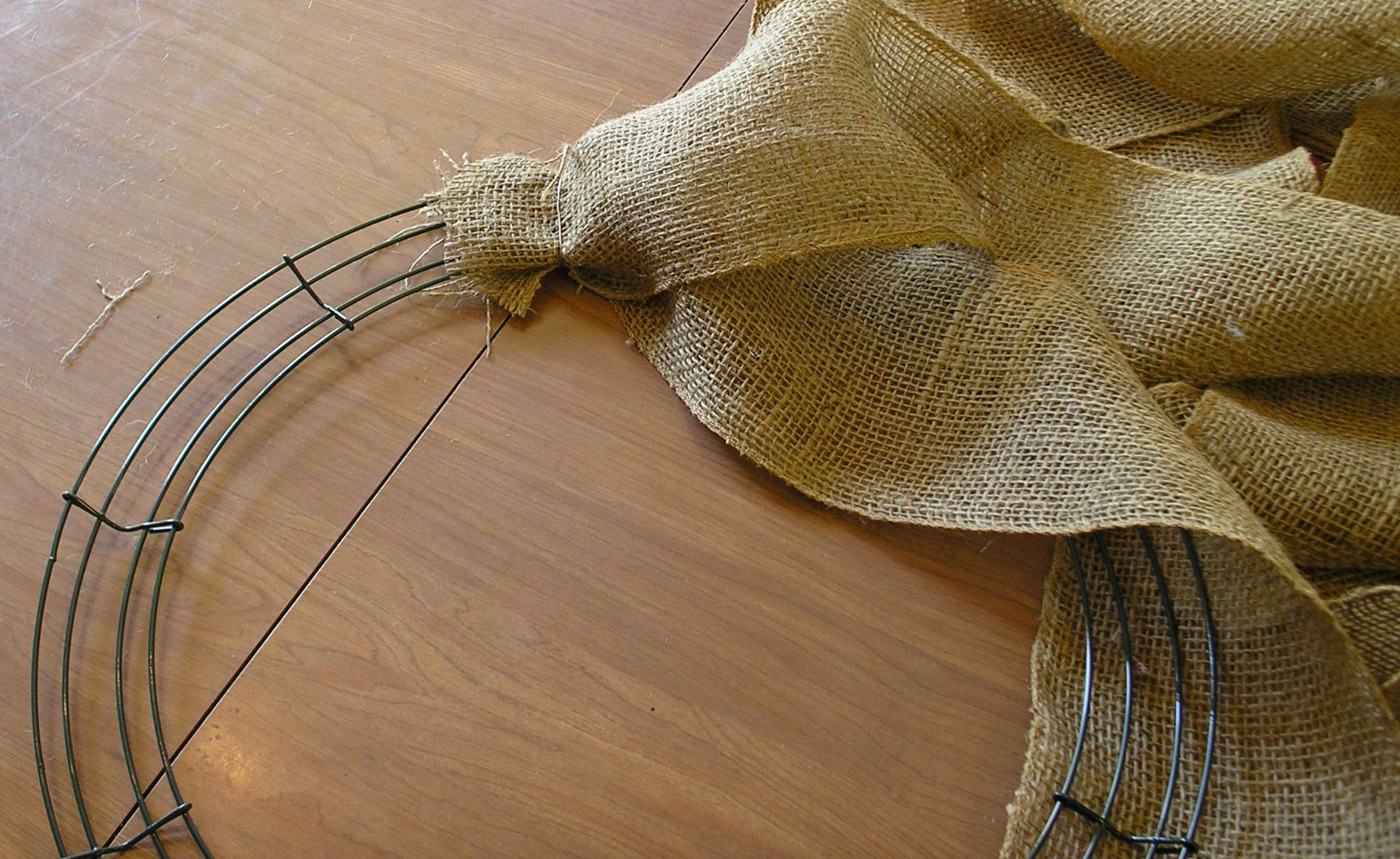 Measure out three strips of burlap each strip should be equivalent to